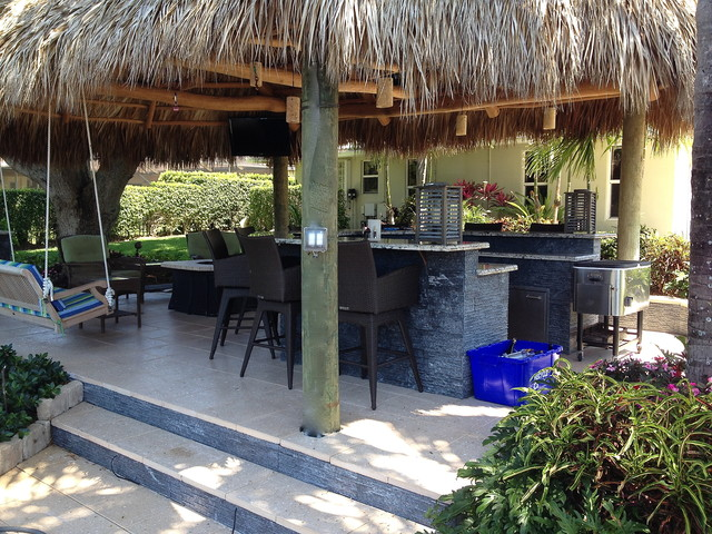 Example of an island style home design design in Miami - Tiki Hut, Outdoor Kitchen And Landscaping - Tropical - Miami - By