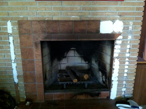 I recently bought a 1963 ranch with floor to ceiling brick fireplaces. Somewhere in her history someone added mantels and surrounded the hearth with tile. Hammering and chiseling is very hard. Anyone do this who can give me some tips and pointers that might make is less laborious? No chemical sugges...
