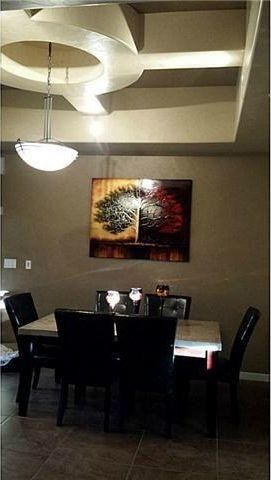 Light Fixture Does Not Match Table But Options Limited With Ceiling