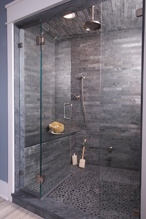 gray bathroom with silvery quartzite walls and mosaic pebble flooring