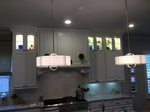 Lighted, glassed, stacked upper kitchen cabinets