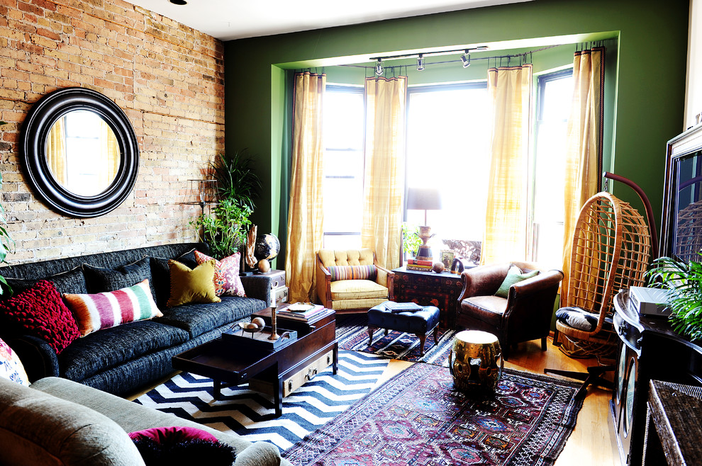 Eclectic enclosed living room photo in Chicago with green walls