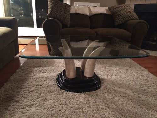 Is this faux elephant tusk table set worth anything?