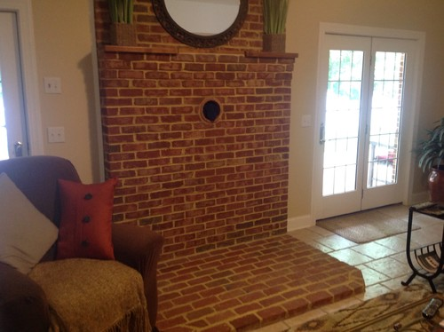 We moved into a house that had a wood burning stove sitting on a pad of exposed brick. It was very country/rustic