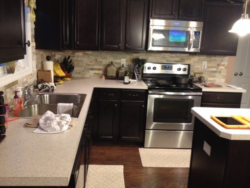 I have recently installed a stone backsplash in my kitchen. I want to add character to my fireplace by adding a veneer/trim of sorts. My question is