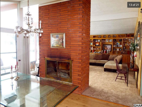 Furniture Placement In A Mcm Living Room With Floor To