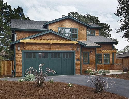Natural Cedar Shingle Craftsman Home With Dark Green