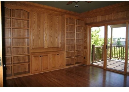 Staining wood floors but now wood paneling and bookshelves Should i paint wood paneling