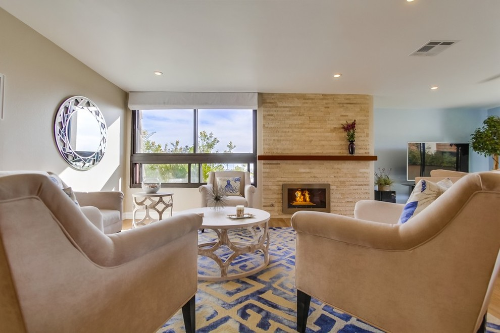 Fireplace, mantel & living room seating.