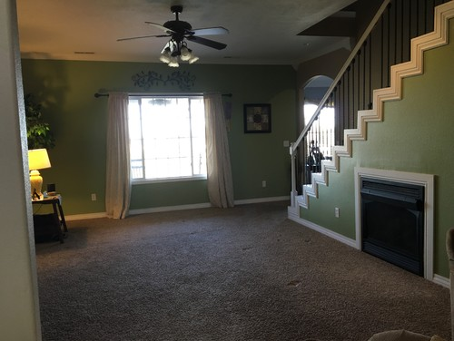 Living Room Fireplace Under Stairs