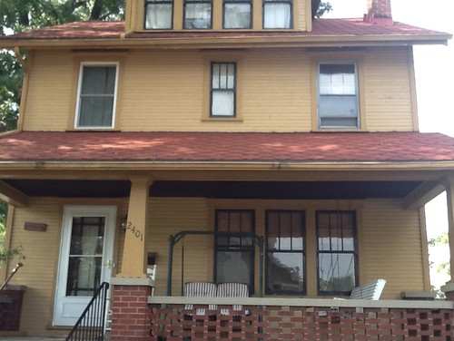 what color do i paint my 80 year old red roof 2 story house