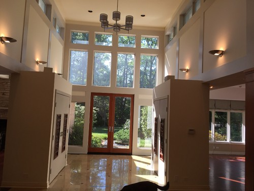 Separation element between foyer and dining room in open concept