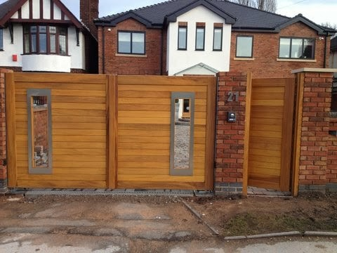 Wooden driveway gates modern home fencing and gates for Driveway gate designs wood