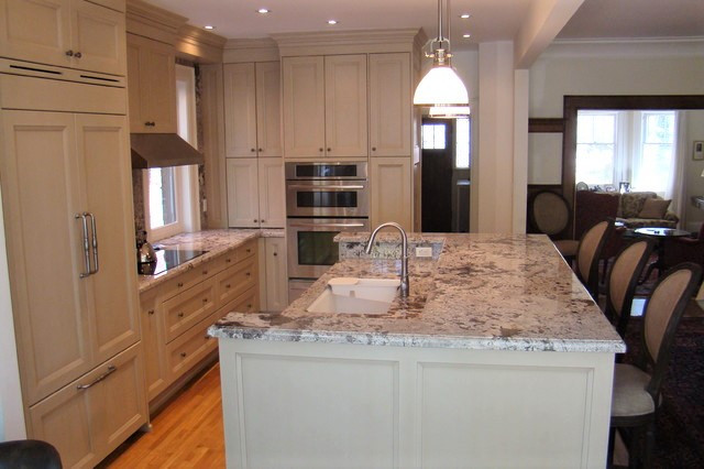 Total Transformation - load bearing wall between kitchen and dining room was rem