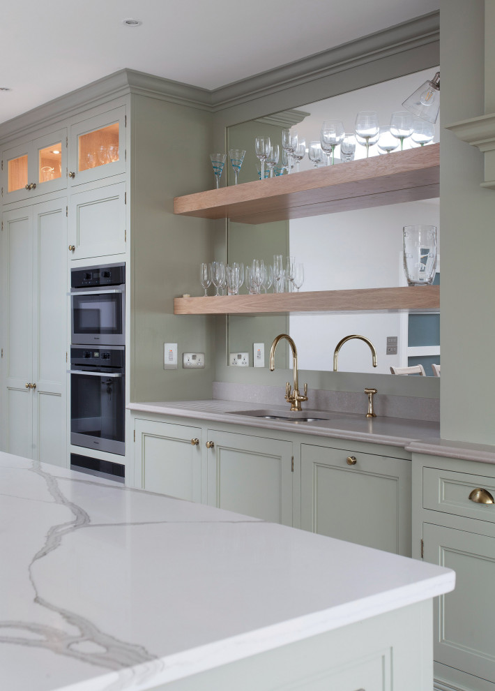 Eat-in kitchen - mid-sized french country single-wall eat-in kitchen idea in Other with recessed-panel cabinets, green cabinets, wood countertops, an island and white countertops