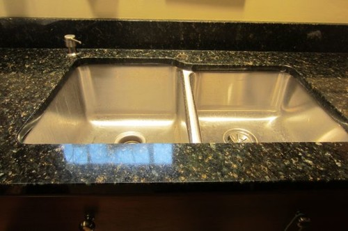 Undermount sink edge intrudes on cut-out for faucet