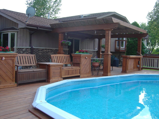 Cedar deck around the pool traditional chicago by for Above ground pool decks with lattice