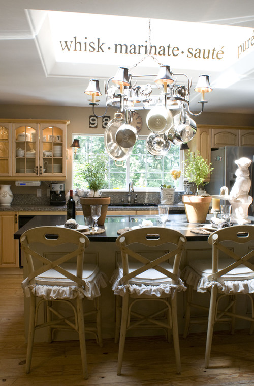 Melaine Thompson traditional french country kitchens design. This one has the signature ruffled chair covers