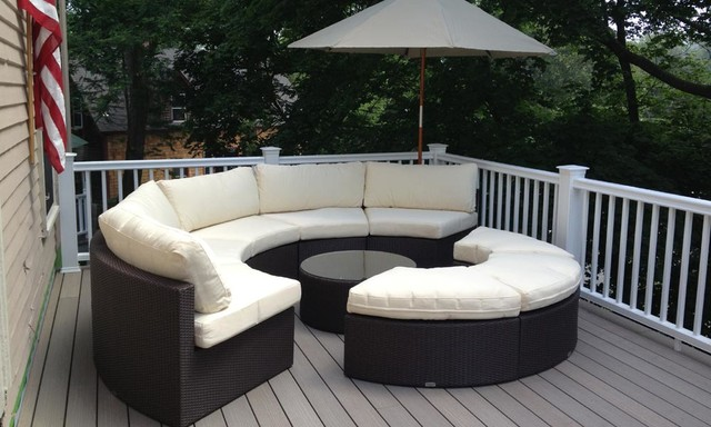 Round outdoor wicker sectional couch set traditional for Circular garden decking