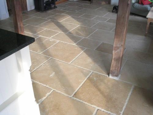 Travertine floor tiles.
