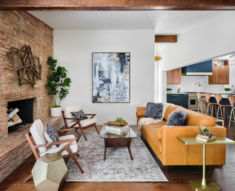 Mid-sized mid-century modern open concept medium tone wood floor, brown floor and exposed beam family room photo in Austin with white walls, a standard fireplace and a stacked stone fireplace