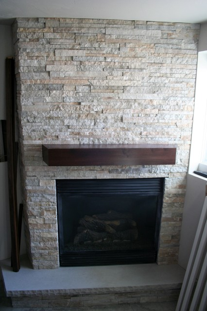 Stacked Stone Fireplace modern-basement