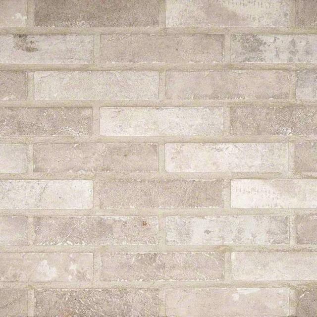 "Capella Ivory Brick 2""x10""."