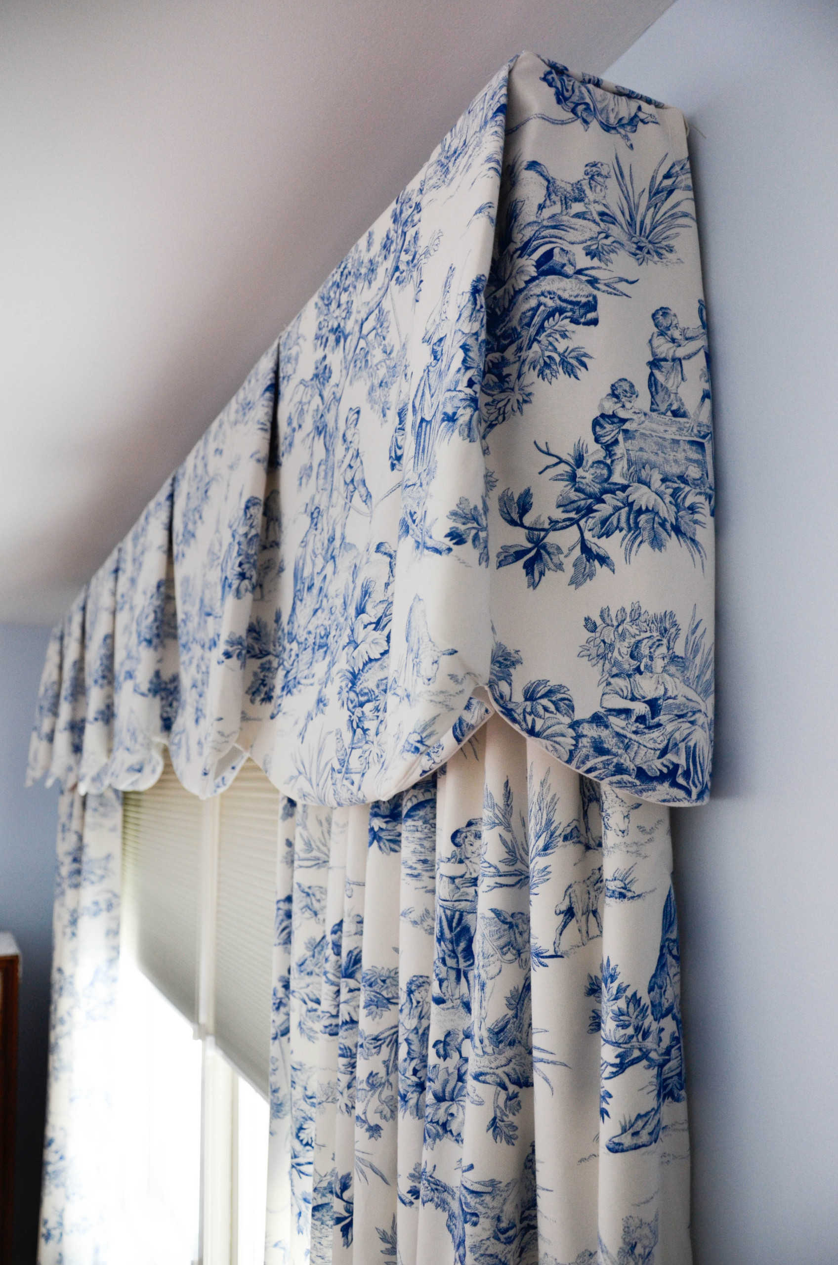 Blue and white toile Sheffield valances and draperies in a master bedroom
