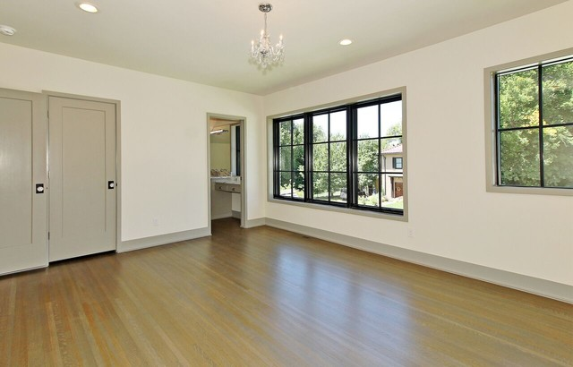 Large transitional guest carpeted bedroom photo in Other with white walls and no fireplace