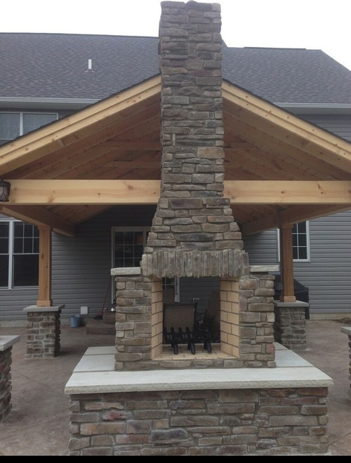 Firerock see-thru fireplace with Susquehanna Ledgestone manufactured Veener by Heritage Stone and custom limestone wall caps.