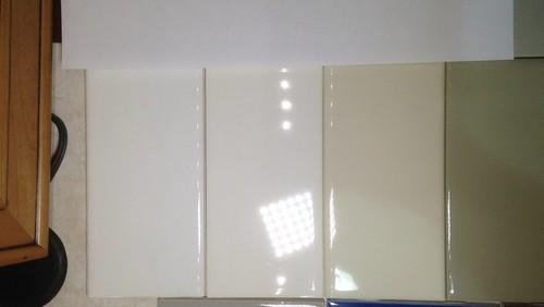 arctic white standard white almond std gray all against a sheet of white paper for balance - Daltile Subway Tile