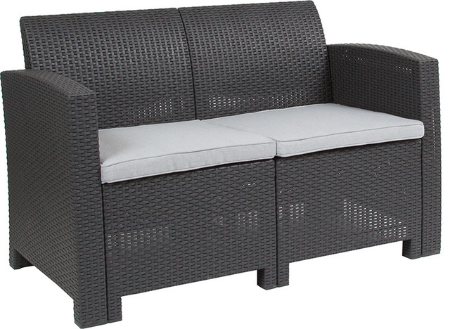 Dark Gray Faux Rattan Loveseat With All-Weather Light Gray Cushions.
