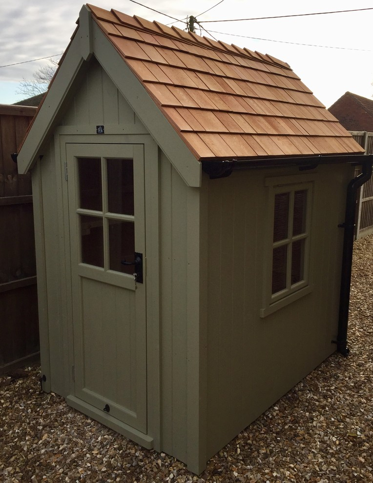 This is an example of a small modern detached garden shed in Other.