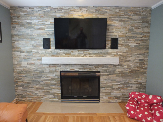 Our faux wood Sandblasted mantel was painted white to go with the stone accent wall