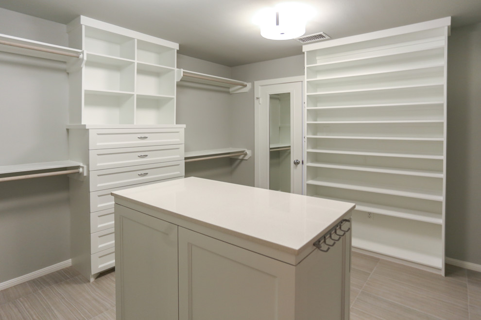 Example of a mid-sized trendy women's porcelain floor walk-in closet design in Houston with shaker cabinets and white cabinets