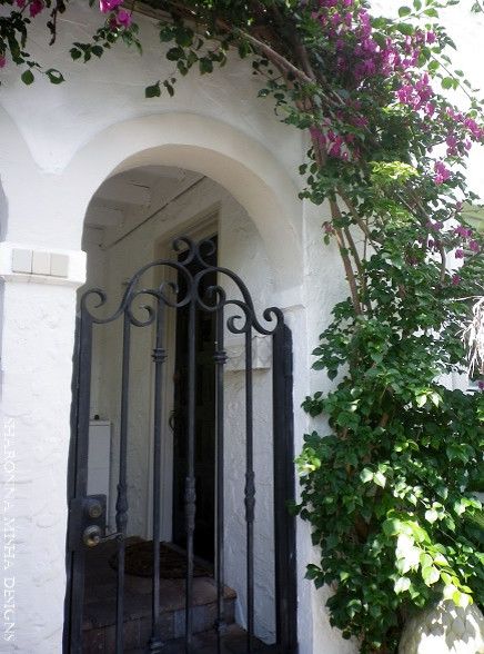 Front Gate Arched Entry On White Mediterranean Home With