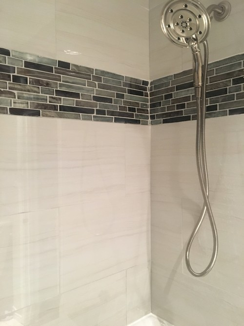Is this poor tiling i am concerned with this professional tiling job the main tiles are not flush and the decorative tiles appear wavy and are also not flush to the wall ppazfo