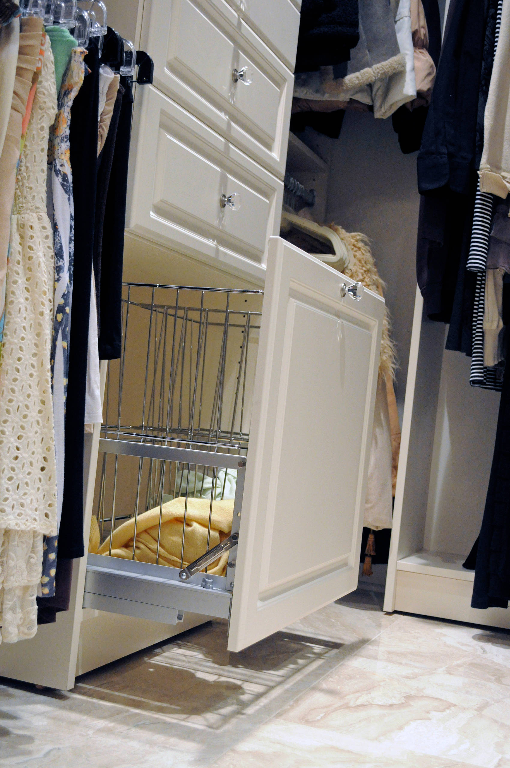 A double pull out laundry hamper with soft close draw slides.