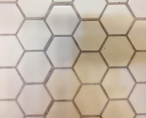 Help! Poorly laid Hex tile - Should we have it redone?