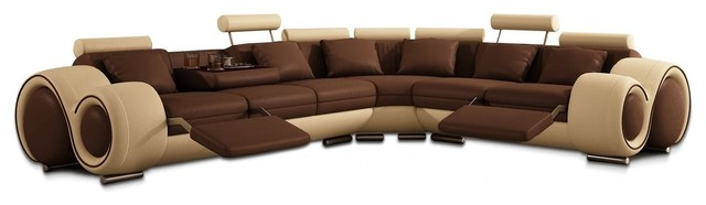 beige and brown leather sectional sofa with builtin footrests