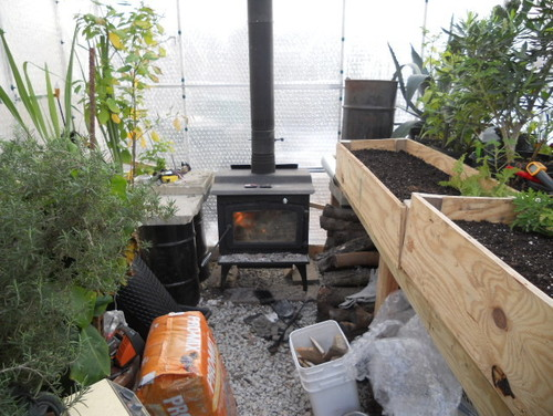 Wood stove in greenhouse for Garden pond heater