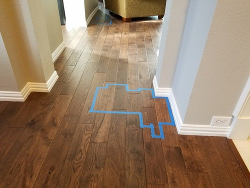 Solid wood floor glued down on concrete: hollow spots