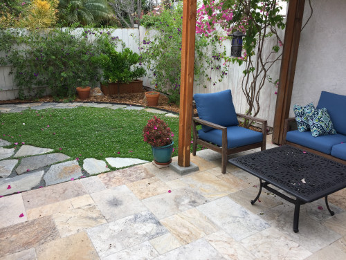 Dog Patio Ideas - Small stone patio with   small grass area next to it.