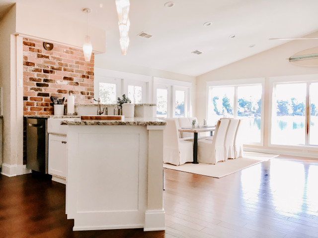Inspiration for a mid-sized eclectic medium tone wood floor and brown floor great room remodel in Charlotte with yellow walls