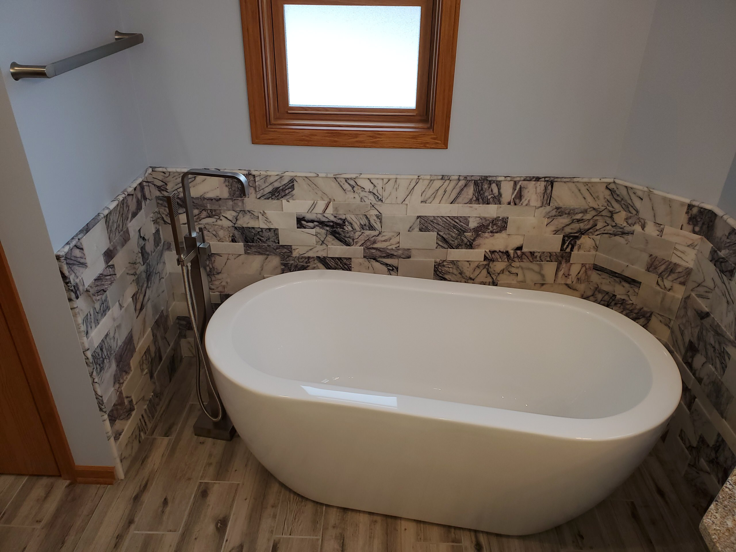 Free standing tub in redesigned master bathroom