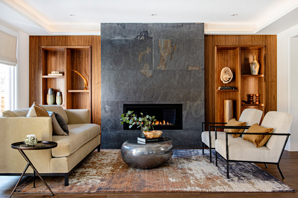 Inspiration for a mid-sized contemporary open concept medium tone wood floor, wood wall and brown floor living room remodel in Toronto with white walls, a ribbon fireplace and a stone fireplace