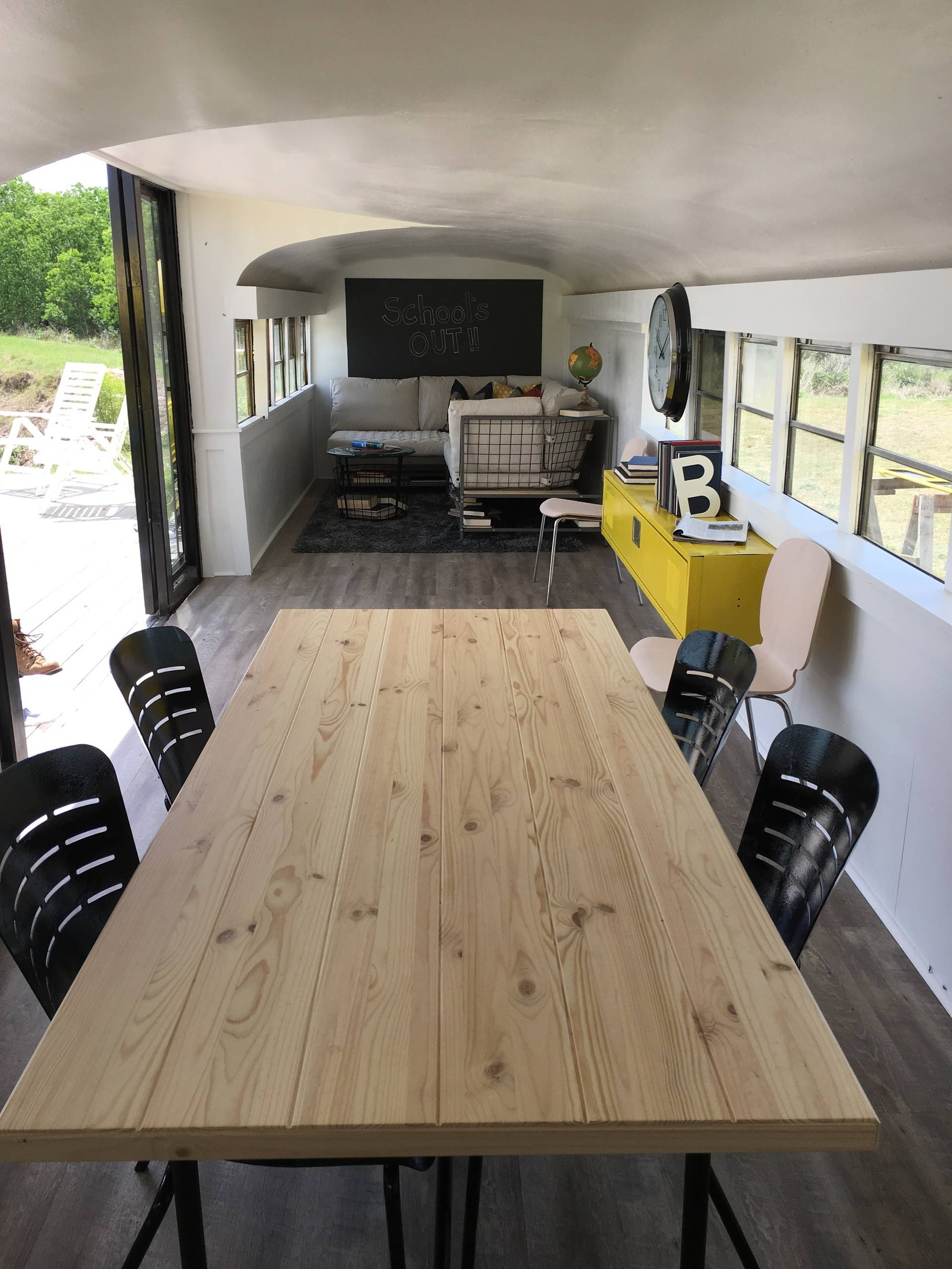 Vintage busses merge into a new tiny home