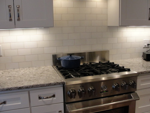 Marble backsplash for me too. No problem with stains. I did have the tile  guy come back and seal it for a second time. If once is good, twice is  better, ...