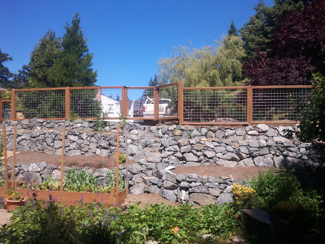 terraced rock walls and hog wire fence rustic
