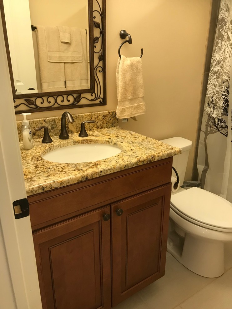 Finished Basement Bathroom with ceramic tiled floor and tub
